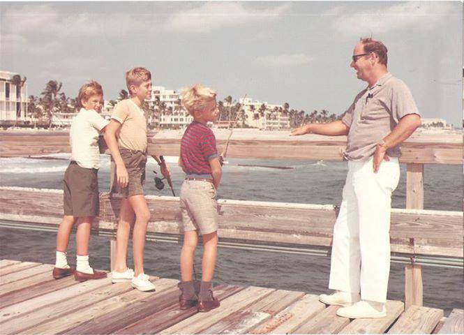 Charley Carvin with his children, Chris and James and a friend on the Palm Beach Pier before the Town had it raised.